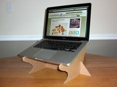 Recycle and get your laptop off the table and stop hunching over to see the screen with this DIY cardboard laptop stand. Description from greenupgrader.com.