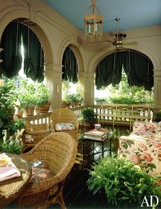 Well decorated veranda, complete with chintz sofa, by the late, great Anthony P. Browne.