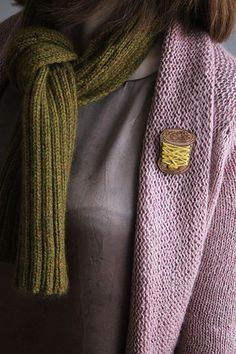 Dark grey-mauve with pretty pastel mauve and olive green.