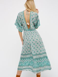 Kombi Folk Dress | Lightweight midi dress with a comfortable fabrication and a beautiful mixed bohemian print. V-neckline with cute tasseled ties at the open back. Easy, wide sleeves.