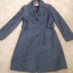Preowned women coat size 8 Preowned  coat for women size 8.                   51 % wool 34% polyester 10% acrylic 5 % other fibers body lining 100% polyester Larry Levine Jackets & Coats