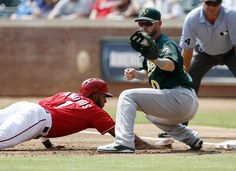 CrowdCam Hot Shot: Texas Rangers shortstop Elvis Andrus dives back to first ahead of the throw to Oakland Athletics first baseman Daric Barton during the first inning of a baseball game at Rangers Ballpark in Arlington. Photo by Jim Cowsert