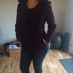 Purple/burgundy American Rag pea coat Dark purple/slight burgundy, pea coat with collar from American Rag/Macy's. Excellent condition. Buttons up front, has hood, sits at waist length. American Rag Tops
