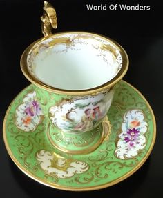 antique all hand painted cup and saucer eagle handle, Dresden