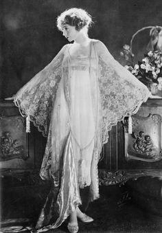 Lilian Gish wearing a lace peignoir, circa 1925. Photograph by James Abbe.