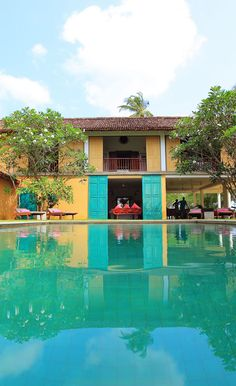 An ochre-coloured pavilion surrounds a turquoise-coloured swimming pool. #Indistay | The Last House, Sri Lanka