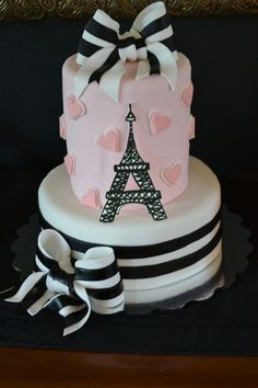 Paris cake - Client loved two totally different cakes, so I did a mash-up and made the top tier a barrel cake. GP Eiffel tower and white part of bows, fondant everything else