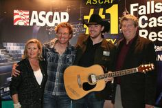 """ASCAP's Connie Bradley, Cory Batten, Chris Young and ASCAP's Dan Keen at the """"Gettin' You Home (Little Black Dress)"""" No. 1 party on Nov. 24, 2009 Photo By: Marilu White"""