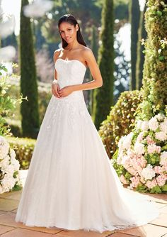 "25261 - Mercer - Say ""Yes"" to this all over lace strapless bodice ball gown. The beaded Venice detail will definitely catch your audience's attention. The look gets more beautiful with a corset back. Available here in size 22  Try this beauty on at Aurora Bridal in Melbourne, FL 321-254-3880"