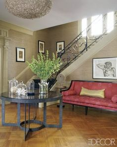 A Lucian Freud drawing in the foyer; the chandelier is by Ironies, the table is by Gregorius Pineo, and the grass-cloth wall covering is by Donghia.