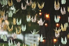 500 origami paper cranes hung from the willow tree where the couple said their vows http://su.pr/1Q5mll photos by Jessica Janae Photography