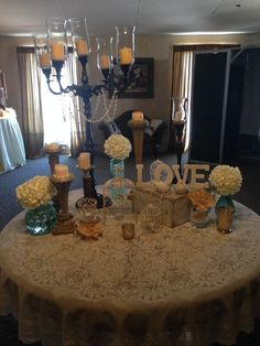 Jade green and ivory lobby table with vintage decor!