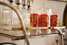 Highball glasses with a red-and-gold paisley motif.