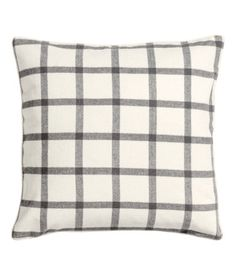 Cushion cover in checked, slightly felted fabric with piping at edges. Concealed zip. Size 20 x 20 in.