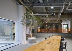 Japanese studio Torafu Architects remodelled the basement level space in the Ebisu area of Tokyo for global advertising agency AKQA.