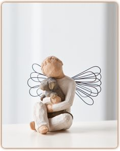 Angel of Comfort . . .   Offering an embrace of comfort and love . . .    Welcome back, Angel of Comfort. We've missed this sweet little boy angel, hugging his best friend. Angel of Comfort is the only boy figure with wings.