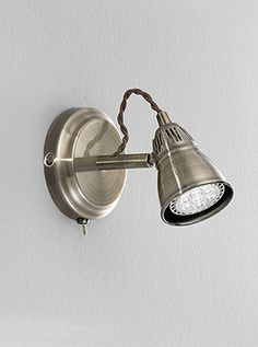 SPOT8951 Ristica LED single wall light bracket, bronze. Bronze finish spotlights with a decorative rope cable behind the fully adjustable heads.  Switched with a toggle switch. Supplied with 4.5W LED lamps which are not dimmable. 1 x 4.5w GU10 LED Lamps included 3000k Height- 12cm (max) Width- 10cm (max) Prjection- 17cm (max) BRAND- Franklite REFERENCE- SPOT8951 AVAILABILITY: 3-4 Working Days