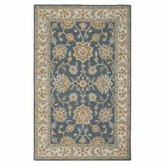 Wool rug with a floral design in navy and ivory. Hand-tufted in India.  Product: RugConstruction Material:  New Zealand woolColor: Navy and ivoryFeatures: Hand-tuftedMade in IndiaNote: Please be aware that actual colors may vary from those shown on your screen. Accent rugs may also not show the entire pattern that the corresponding area rugs have.