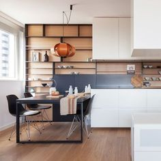 A Masculine, Minimalist Apartment in Barcelona Designers at local firm Ylab Arquitectos reinvent a seamless open-plan home in one of the city's coolest neighborhoods