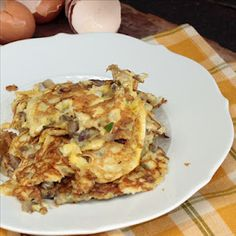 Indian omelet -  with chopped green  chilies, chopped onions, cilantro leaves, cumin powder, turmeric powder and chopped tomatoes.