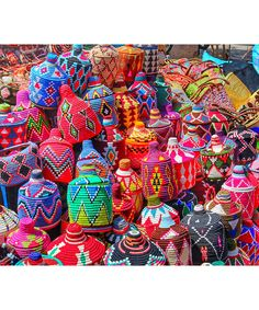A travel diary through Marrakech—hotels, food and activities in Morocco: We cruised through the walled medina and into various souks, where I spotted these vibrant handwoven baskets. Major Moroccan eye candy.