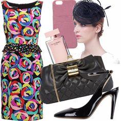 È  un'occasione importante che non può cogliervi impreparate. Abbiniamo un vestito allegro, colorato ed elegante della Boutique Moschino con scarpe, borsa e cappellino rigorosamente neri, ma ricchi di personalità. Per completare un pizzico di rosa all'interno della borsa: porta-cellulare e profumo... Eccovi pronte!