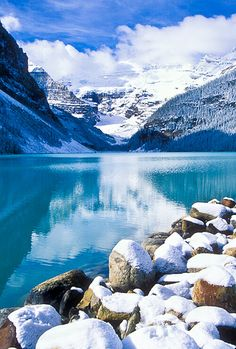 A September snow covers the rocks along the shore of Lake Louise. Banff National Park, Alberta, Canada.