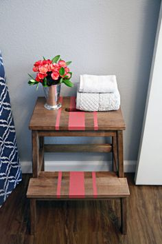 The BEKVAM step-stool is a double-duty bathroom organizer: You can use it to give kids a boost when they're brushing their teeth or washing up, then rest hand towels on it the rest of the time. Click through the gallery for more IKEA bathroom storage hacks.