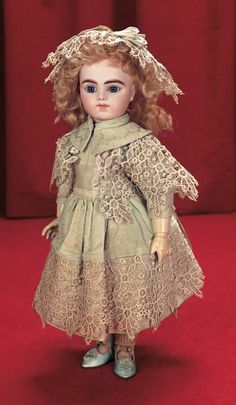 """*AN ALL-ORIGINAL FRENCH BISQUE BEBE BRU IN ORIGINAL BOX, 16""""t. ~ Bisque socket head, blue glass paperweight inset eyes.....MARKS: Bru Jne R 6 (head) Bebe Bru No. 6 (torso).  COMMENTS: MAISON BRU, c. 1892.....Theriault's Antique Doll Auctions"""