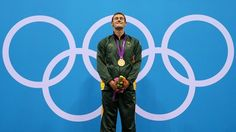 Gold medallist Cameron van der Burgh of South Africa poses on the podium during the Victory Ceremony following the men's 100m Breaststroke final on Day 2 of the London 2012 Olympic Games at the Aquatics Centre.  Related tags
