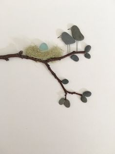 Pebble art by sharon nowlan 8 by 15 with sea glass egg and mommy and daddy birds framed pebble art