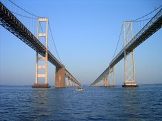 Chesapeake Bay Bridge that connects Norfolk Virginia to Wilmington Delaware, is17.6 miles long.  It is 4 lanes above water and 2 lanes when it goes under the Atlantic Ocean.  It is from 40 feet to 75 feet when under the ocean.