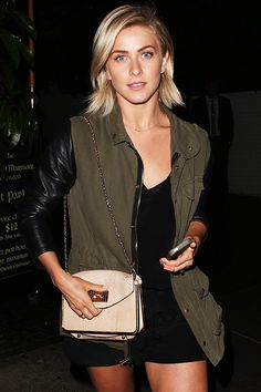 Dancing With the Stars alum Julianne Hough left Chateau Marmont in the late hours of August 13th in an outfit that's the perfect mix of relaxed-cool and chic. The blonde dancer rocked a black vee neck tee, shorts, and an army jacket with leather sleeves. She also carried a pale pink snakeskin crossbody for her night out in Hollywood.