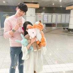 """((Rp))Adellina squeals as she hugs the stuffed animals closer to her """"THERE SO FLUFFY!"""" She continues to squeal not caring about the people who were staring as the walked Vernon had brought her more stuffed animals then she can hold by herself"""