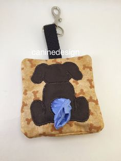 Dog Bag Dispenser Brown Dog Bone Pet Waste Bag by caninedesign. So cute to hang on my leash or treat bag and it makes having a bag easy.
