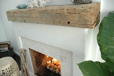 Driftwood Mantel adds plenty of texture. Rustic Fireplace Mantle, Brick Fireplace Makeover, Wood Mantels, Rustic Fireplaces, Home Fireplace, Fireplace Surrounds, Fireplace Design, Fireplace Ideas, Stucco Fireplace