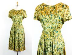 """Vintage 1950s dress . Dappled Afternoon . abstract green leaf print 50s day dress with pleated skirt  . 28"""" waist by VoyeurVintage on Etsy"""
