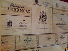 DIY wall deco using wood panels from (consumed) wine boxes. Amazing