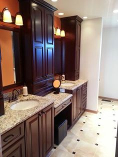 Giallo ornamental granite brings out the mahogany in the cabinets perfectly.Click To Enlarge