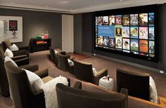media room | Cinema-like media room with brown chairs and big screen / by ...