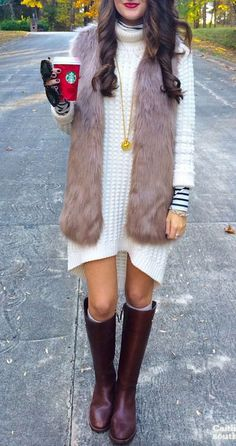 Women's fashion | Turtle neck white sweater dress over striped shirt with fur vest and burgundy rain boots