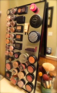 DIY. magnetic makeup holder holding your mascara with you toes is kinda uncomfortable.