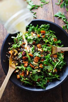 Roasted Sweet Potato, Wild Rice, and Arugula Salad: served with a simple lemon and olive oil dressing. I licked the plate clean. #sugarfree #vegetarian #vegan #cleaneating #healthy | pinchofyum.com