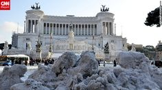 "shot taken in central Rome on Saturday. ""People go out to enjoy the experience as snow is a rare sight in Rome,"" says Buzzi."