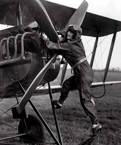 Aviator Poppy Wyndham checks the engines before starting a flight, Oct. 24, 1920. Photo From The New York Times Photo Archives