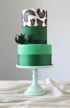 Exotic and beautiful three-tier cake by Charm City Cakes. Two shade of green…