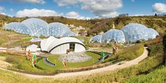 The Eden Project in Cornwall, UK, is a collection of unique artificial biomes containing an amazing collection of plants from around the world. Located in a reclaimed quarry in Cornwall, the complex consists of huge domes that look rather like massive igloo-shaped greenhouses. Each houses thousands of different plant species in tropical and Mediterranean environments