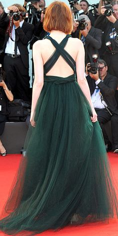 in a deep-green Valentino gown with a plunging front and back (sept 2014)