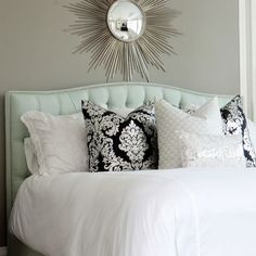 Beautiful master bedroom design with soft gray brown walls paint color, silver sunburst mirror, blue tufted headboard bed, white damask pillows, silver metallic lumbar pillow and hot pink round faux croc mirrored tray. Master Bedroom Design, Home Bedroom, Bedroom Decor, Bedroom Photos, Master Bedrooms, Peaceful Bedroom, Calm Bedroom, Bedroom Ideas, Bedroom Inspo