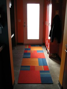 Cut up floor tiles and samples and make your own rug!  Clever! Creative!